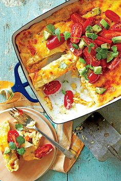 Breakfast Enchiladas - 50 Top Rated  Recipes of 2016 - Southernliving. Recipe: Breakfast Enchiladas  Reimagined for easy weeknight cooking, this Tex-Mex breakfast mash-up has buttery eggs and a homemade cheese sauce to top it off.