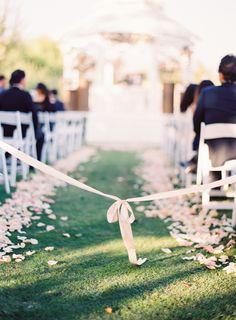 Ribbon-tied ceremony aisle: http://www.stylemepretty.com/2016/05/12/simple-elegant-blush-wedding/ | Photography: The Great Romance - http://thegreatromancephoto.com/