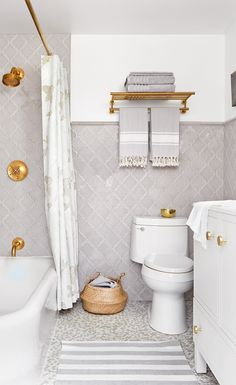 A dated bathroom receives a modern makeover that pays homage to its 1920s beginnings. | Image: Donna Griffith | Designer: Stacy Begg | Styling: Ann Marie Favot #StyleatHome #bathrooms #vintage