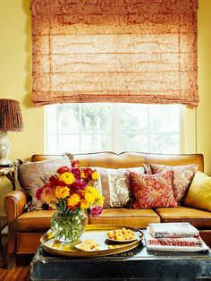 A living room with bright mustard walls and cayenne and curry accents.