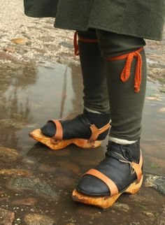 Medieval pattens. They keep feet warm and dry, and make a fabulous noise when walking on cobblestone pavements.