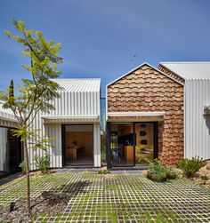 Interesting use of timber shingles, with metal roofing.