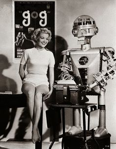 In February 1954, Sally Mansfield was on hand to help Garco, 'Hollywood's first mechanical press agent', as he 'batted out a hot press release about a new science-fiction movie called Gog. The new film is all about robots, so the producer though Garco would be the ideal fellow for the job of handling advertising (&) publicity... Operated by remote control, the robot can perform with his arms & hands virtually on a level with a human.' Garco, represented a million dollars in electronic…