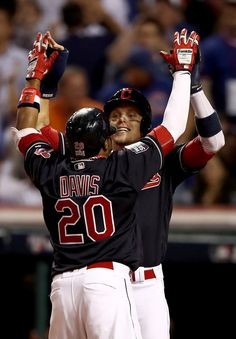 Rajai Davis #20 of the Cleveland Indians celebrates with Brandon Guyer #6 after hitting a two-run home run during the eighth inning to tie the game 6-6 against the Chicago Cubs in Game Seven of the 2016 World Series at Progressive Field on November 2, 2016 in Cleveland, Ohio. (Nov. 1, 2016 - Source: Elsa/Getty Images North America)