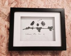 Pebble art picture, hand made in Ireland.. Made from pebbles found on Killiney beach in Dublin, Ireland. A great gift to welcome a new arrival into a family or a gift for a christening or naming ceremony. This picture shows 2 parent birds and a baby bird. Its is also gender neutral- suitable foe same sex couples. While no two pieces are the same, if you like any of the pieces you see, I can create pieces in a similar style. Please feel free to contact me