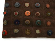 """Sophie Digard calls the velvet and crocheted baubles at the center of each woolly square """"biscuits"""""""
