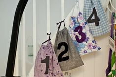 lovely advent idea. Little numbered bags tied to the banisters.