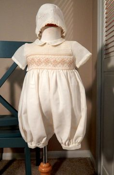 This boy outfit is smocked in the front, with short pants and short sleeves. It has an elegant look. The back has 3 buttons. It is made by Mexican