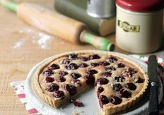 A wonderful cherry tart recipe, originating from the village of Ripe in Sussex, made with shortcrust pastry, an almondy filling and luscious sweet cherries. No Bake Desserts, Delicious Desserts, Dessert Recipes, Yummy Food, Dessert Tarts, Cherry Bakewell Tart, Cherry Tart, Blue Cherry, Manchester Tart Recipes