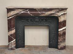 Cheminée ancienne de style Louis XIV en marbre Campan Rubané