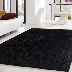 Hand-tufted Solid Black Thick Plush Shag Area Rug