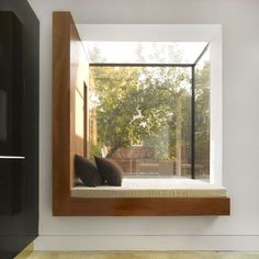 Would love to sit, read, and nap in this window seat!