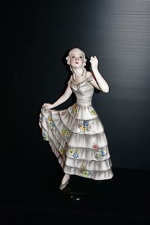 $1,900.00  A truley beautiful figure.Early lorenzl piece from Austria signed to base  This figure features an elegant you women in a low cut floral dress  with her hands poised ,very stylish with a great polychrome glaze.  A must have for that rare model collector of early goldscheider.