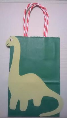 Green Dinosaur Favor Bags!- Set of 12 by LetsPartyFavors on Etsy https://www.etsy.com/listing/180328078/green-dinosaur-favor-bags-set-of-12