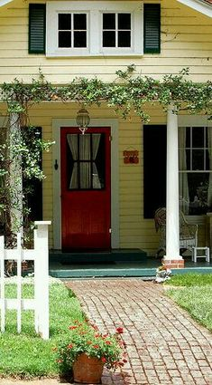 Love the yellow and white with the red door and the black shutters ! Gotta do this :) Luckily the house is already yellow with white pillars and red accents now we only need the black shutters and a red door. Cottage Exterior Colors, Yellow House Exterior, Exterior Paint Colors For House, Paint Colors For Home, Paint Colours, Bungalows, Red Door House, House Porch, Exterior Paint Schemes