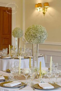 Gypsophila Topiary centrepieces for this White & Gold inspired Wedding at Rudby Hall www.weddingandevents.co.uk