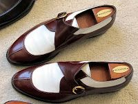 These appear to be by Santoni.....I have them in this combo and black and white.