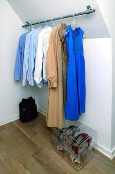 DIY Open Closet Ideas For Your Clothes Rod under the stairs makes a fine open closet.Rod under the stairs makes a fine open closet. Attic Storage, Closet Storage, Storage Spaces, Attic Organization, Storage Ideas, Storage Bins, Bedroom Storage, Attic Renovation, Attic Remodel