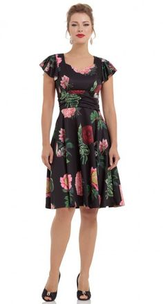 The Vintage Floral Flare Dress dress is a blooming delight. This black dress with big pink florals is bright and bold. It has loose flowing short sleeves, a ruched thick waist panel which creates an empire line which secures your stomach and the skirt flows flare style from the hips.