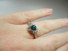 Blue Diamond Engagement Ring, 14k white gold, round cut half carat center stone. $1,133.00, via Etsy.