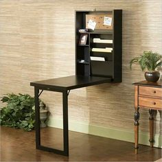 Features:  -Fold out convertible desk.  -Wall mount: Yes.  -Neat and compact design.  -Two adjustable shelves.  -Birch veneer and MDF construction.  -Base is a solid block.  Desk Type: -Floating desk.