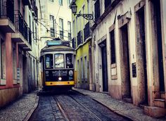 Tram squeezing through the streets of Alfama, Lisbon