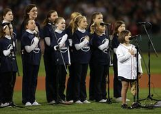 The children of St. Ann's Parish in Dorchester sing the National Anthem before the game. Home of the brave: Little Jane Richard strode on her new prosthetic leg onto Fenway's field to lead a children's choir in a stirring rendition of 'The Star-Spangled Banner.'  Read more: http://www.nydailynews.com/news/national/red-sox-game-sees-marathon-victim-sing-national-anthem-article-1.1485205#ixzz2hkJ4rCW5