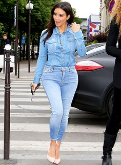 Kim Kardashian wears double denim as she arrives at the 'L'Avenue' restaurant on April 30, 2014 in Paris, France. http://fashionilluminati.com