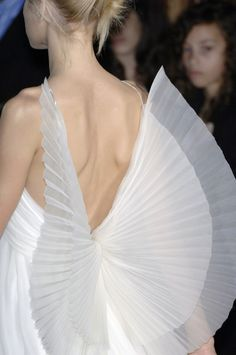 Details: Jessica Stam at Balmain S/S 2007. LOVE. see? you don't need to kill birds and rip out their feathers to get beautiful wings!