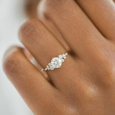 This engagement ring set was designed by Camellia Jewelry. This diamond engagement Ring is set with a ct. round cut natural diamond set on the top of camellia flower . To achieve this stunning look, Weve created a matching diamond wedding band set in Dream Engagement Rings, Rose Gold Engagement, Diamond Wedding Rings, Engagement Ring Settings, Wedding Bands, Wedding Rings Simple, Wedding Gold, Round Wedding Rings, Wedding Ring Styles