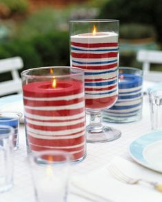 Easy Sand Candles - Pay tribute to the Stars and Stripes (emphasis on the stripes). Red, white, and blue bands of sand dress up votive candles to make flickering lights that are cheerful and fun.