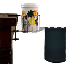My om gave me this & it's WONDERFUL!  You won't spill or leave rings on your items AND it adjust to fit almost any table.  Scrap-MaBob - Drink Holder and Trash Bag at Scrapbook.com $14.99
