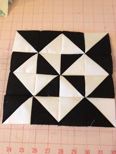 knit 'n lit: Modern Half-Square Triangle Quilt-a-Long Block 19. Click on the website for all of the blocks.