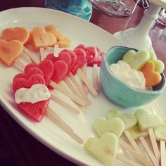 Fruit Hearts on a stick with dip.  Clean food idea for Valentine's Day.