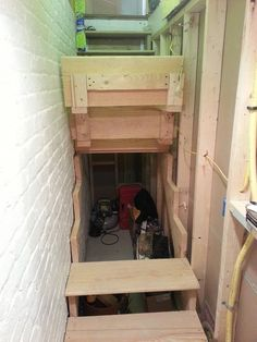 Lift up basement stairs for extra storage.  Pretty cool.