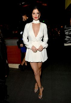 Selena Gomez in White long-sleeved dress with a plunging neckline and thick white collar