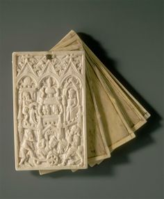 15th or 16th century writing tablet. Tablets of ivory or wood with wax filled compartments were laced together with strips of leather or parchment in the form of a book.  Those on the outside provided a protective cover and the exterior surfaces were often embellished with figurative or geometric carvings.  Biblical scenes, figures of saints or secular images of courtly love and leisure pursuits were popular.
