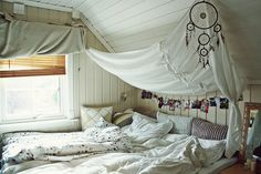 Dreamcatcher, and instead of photos at the head of the bed, prayer flags.