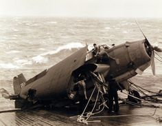 Typhoon Cobra (Halsey's Typhoon), December TBM damaged during the typhoon on board USS Anzio (CVE Personnel salvaging valuable gear. Navy Photograph, now in the collections of the National Archives. Aviation Accidents, Us Navy Ships, Navy Marine, December 17, National Archives, United States Navy, Aircraft Carrier, World War Ii, Marines