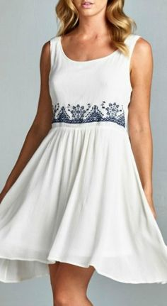 Gorgeous babydoll dress. Features delicate embroidery around waistline. Fully lined. Lightweight. 100% Rayon. Imported.