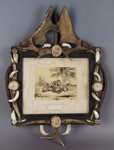 antique carved black forest wall frame with antler decorations