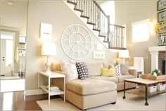 This one is a charming living room that is having beige as the dominant colour along with small pops of yellow and grey accenting the beige colour pretty well.