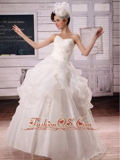 2013 Appliques and Pick-ups Ball Gown Wedding Dress For Custom Made  http://www.fashionos.com  http://www.facebook.com/fashionos.us  Gorgeous wedding gown dress! This wedding gown features a striking sweetheart on fitted bodice wrapped with exquisite embroidery.The dotted embroidery and ruffles embellished overlay highlights the full skirt, which will surely surprise your eyes! The lace up back secures the dress in place. You will be the belle in this fabulous vintage-inspired wedding gown.