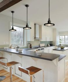 Industrial pendant lights accent a transitional kitchen picture - love those lights