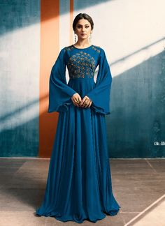 Style and trend will be at the peak of your beauty when you wear this bollywood diva Jennifer Winget style gown style suit. This designer gown suit is beautifully adorned with embroidered, and hand work. Indian Evening Gown, Indian Gowns, Jennifer Winget, Indian Designer Outfits, Designer Gowns, Latest Gown Design, Casual Gowns, Evening Gowns With Sleeves, Party Kleidung