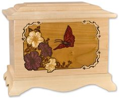 Lovely butterfly cremation urn. 3-dimensional scene with butterfly and flowers. A wonderful memorial urn to honor your loved one.