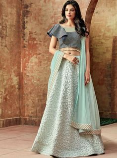 Buy Lehenga Choli for women in various colours & patterns Online. Shop for latest Lehenga Designs at Tithli Fashion. Gorgeous Sky Blue Color Fancy Silk Zari Embroidered Party Wear Lehenga Choli All the fashionable women will surely like to step out in s Lehenga Choli Designs, Lehenga Choli Online, Lehenga Blouse, Silk Lehenga, Heavy Lehenga, Dhoti Saree, Heavy Dupatta, Anarkali Gown, Indian Bridal Wear