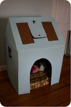 Cardboard Playhouse. My Mom made one for me when I was little but it wasn't this cool...sorry Mom. I am making this for Jaxson!