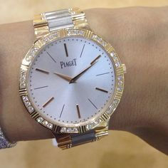 Piaget Dancer Watch. Case in 18K rose gold set with 36 brilliant-cut diamonds (approx. 0.7 ct). Dial adorned with 18K rose-gold hour-markers. Bracelet in 18K white gold and 18K rose gold. Sapphire case back.
