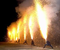 """Tezutsu Hanabi: """"Out of all the impressive fireworks celebrations held annually all around Japan, Tezutsu Hanabi is by far the most eye-catching. Experienced masters hold large bamboo tubes filled with black powder in their arms as flames gush out towards the sky."""""""